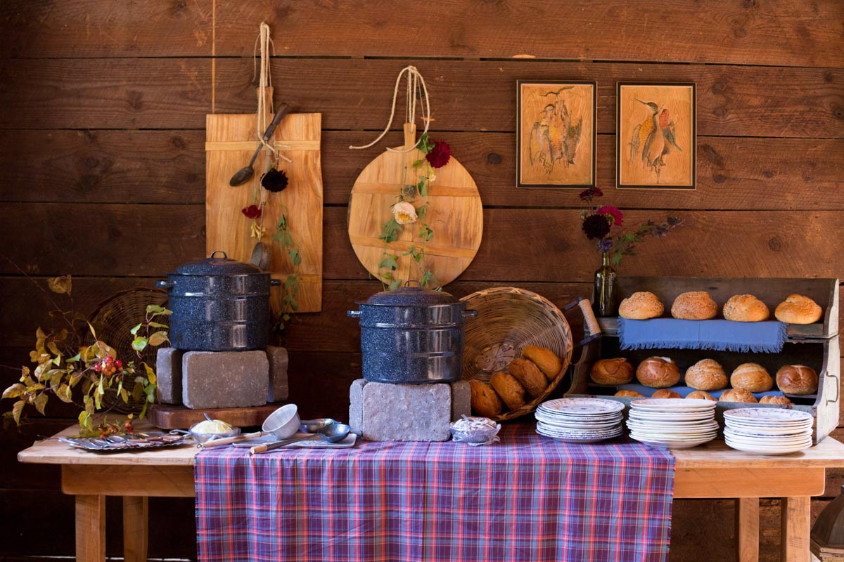 soup and bread table with wooden decorations