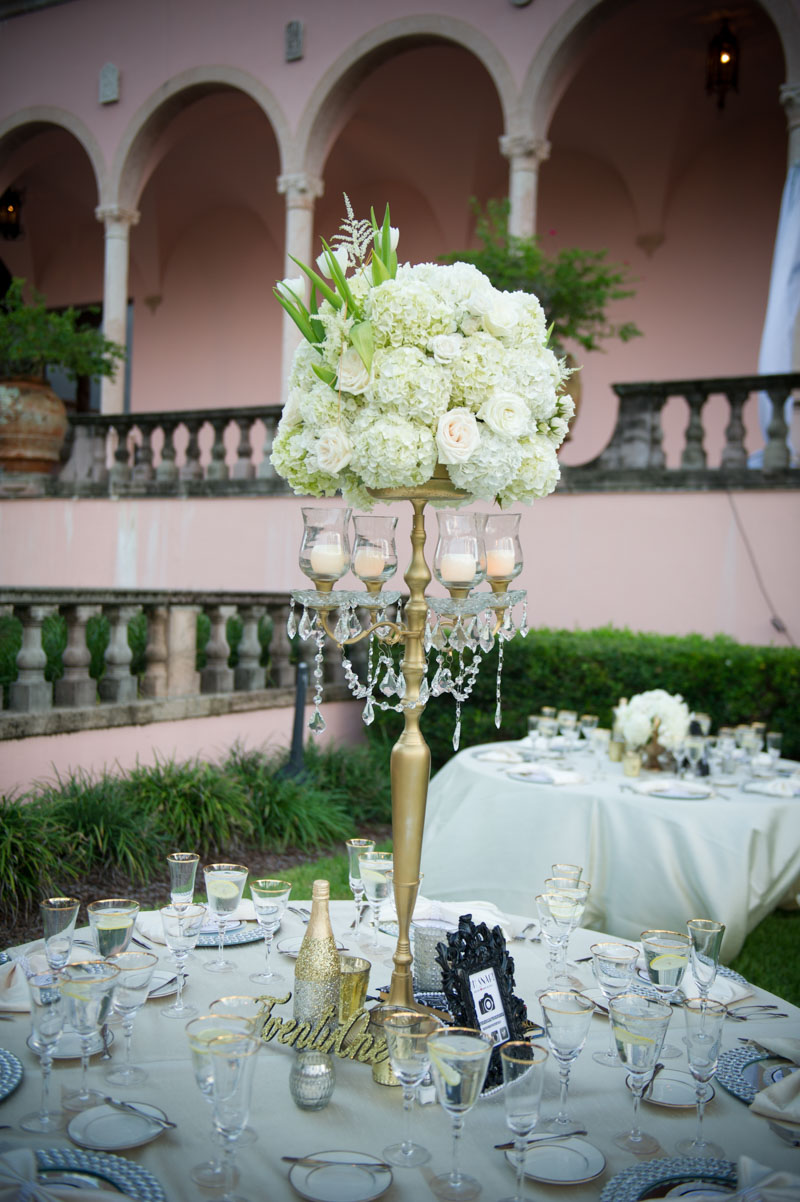 tall gold center piece with hydrangeas and candles