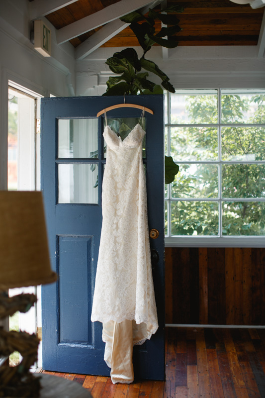 Wedding Dress Against Door