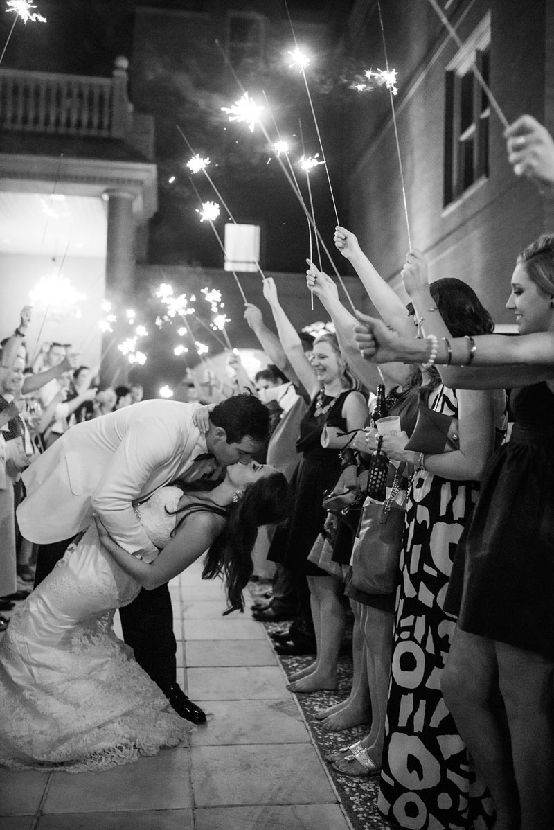 bride and groom exiting in a sparkler tunnel