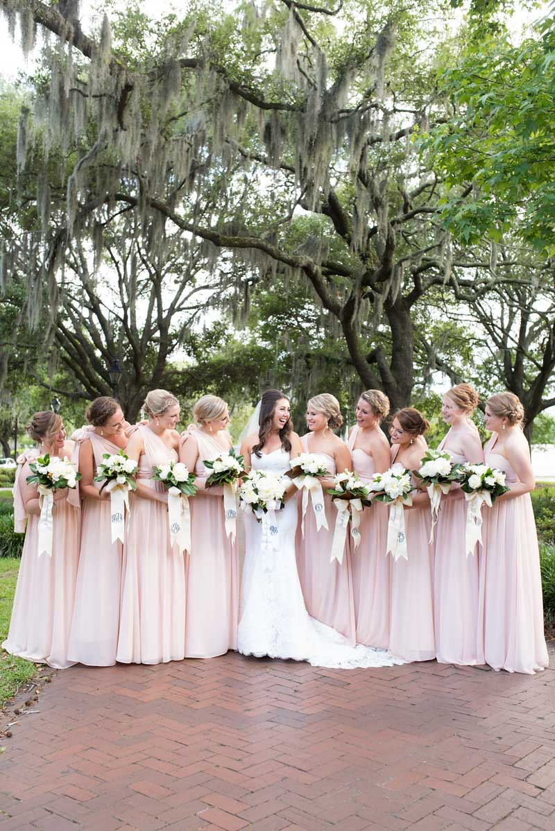 bride and her bridesmaids in blush gowns