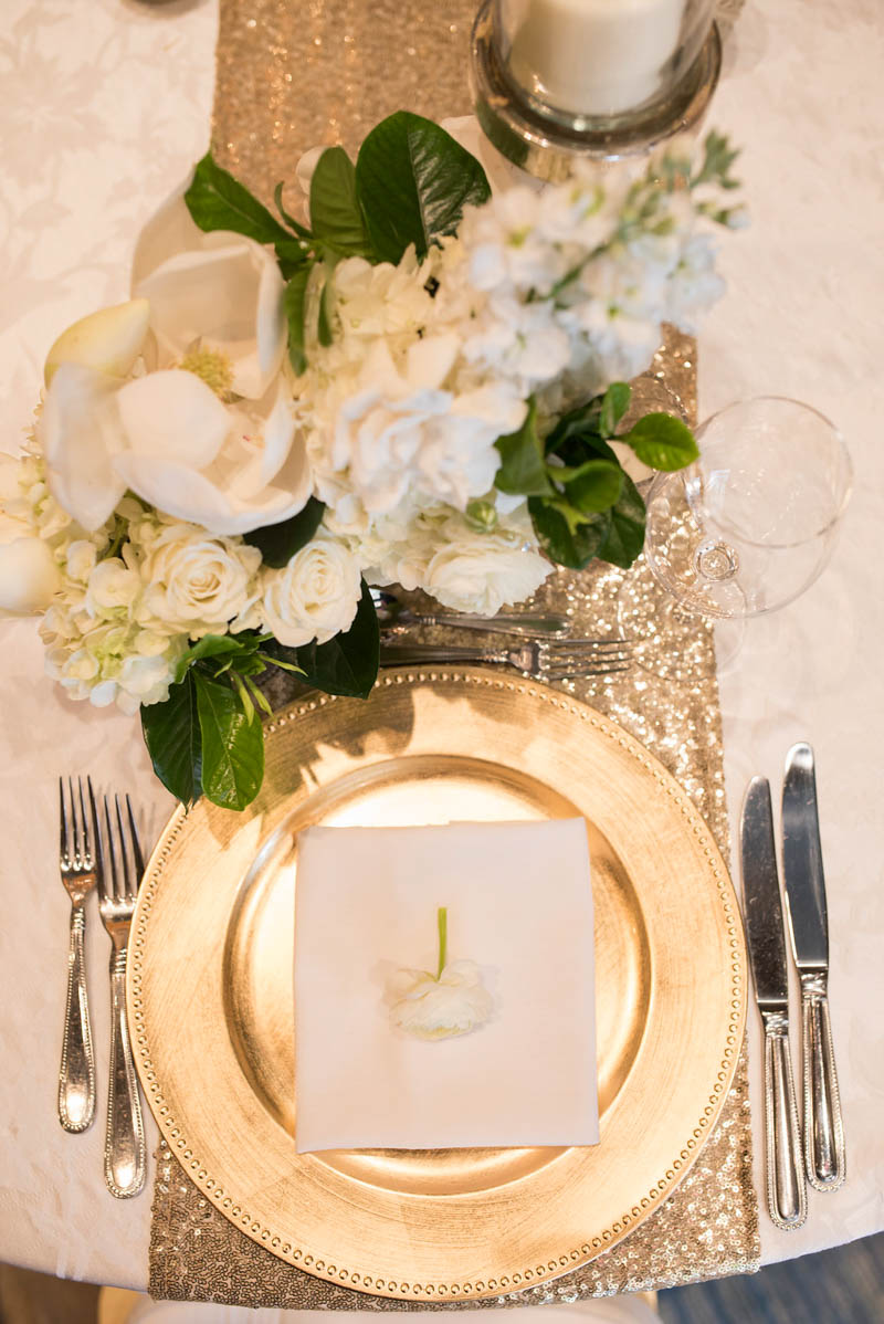 gold plate setting at a wedding reception