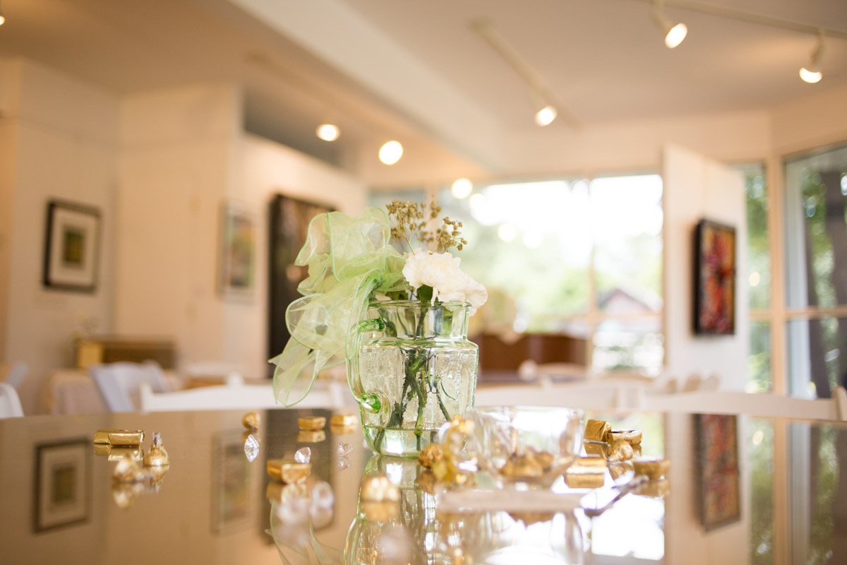 green and gold color scheme for a table setting