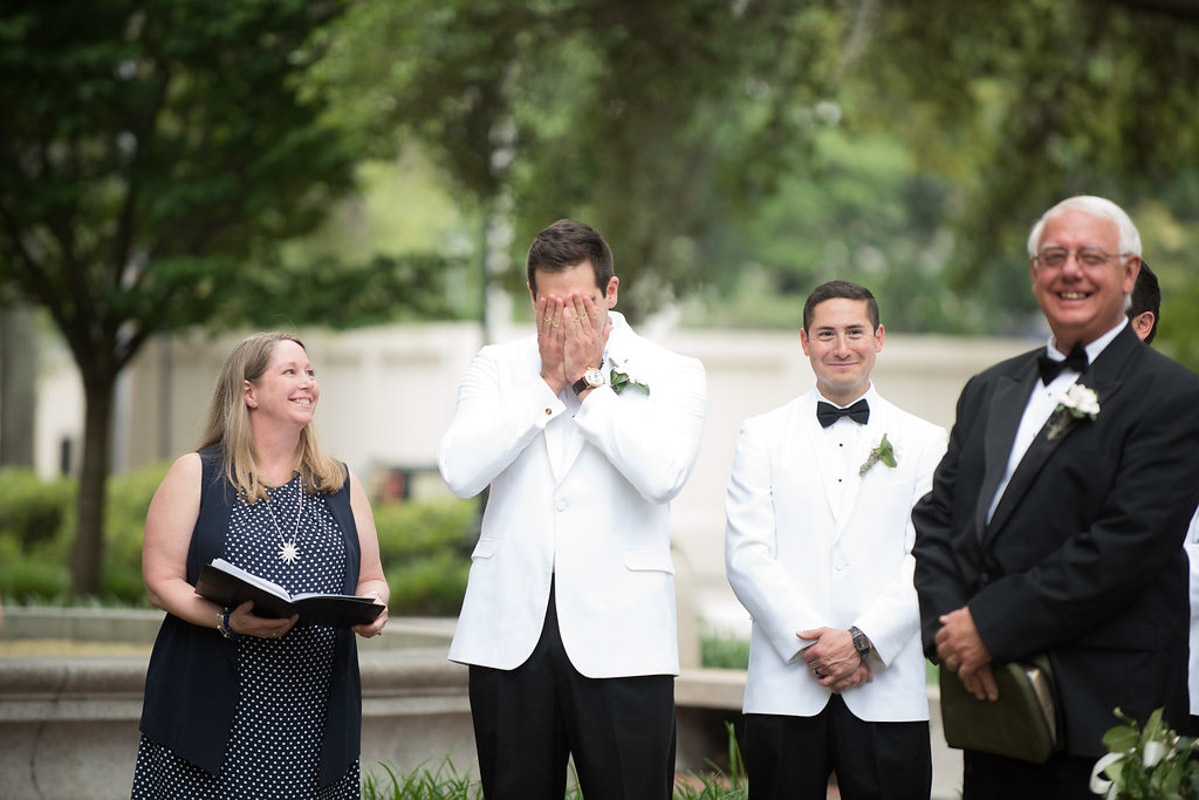 groom getting his first look of his bride