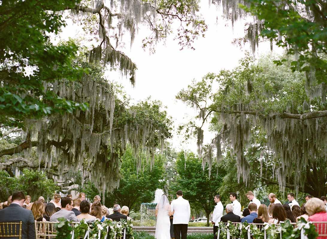 outdoor wedding ceremony under live oaks