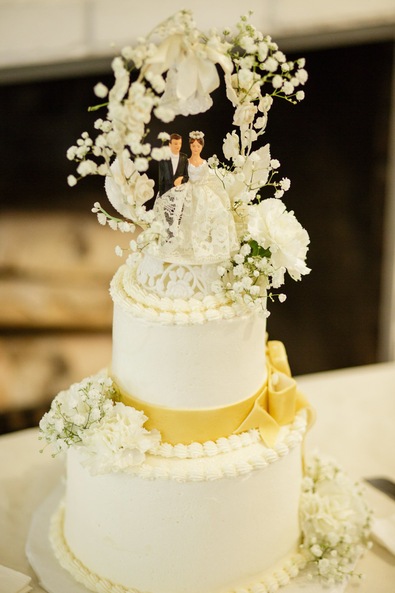 vintage cake topper at anniversary party