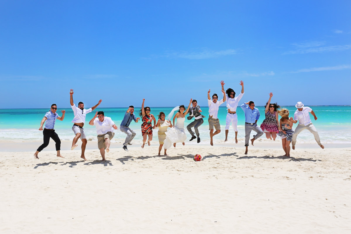 Bridal Party Jumping on Beach_