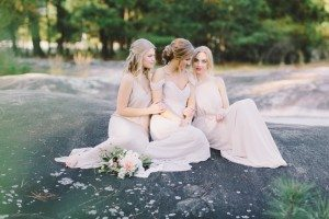 Bride & Bridesmaids Sitting on Rock 2
