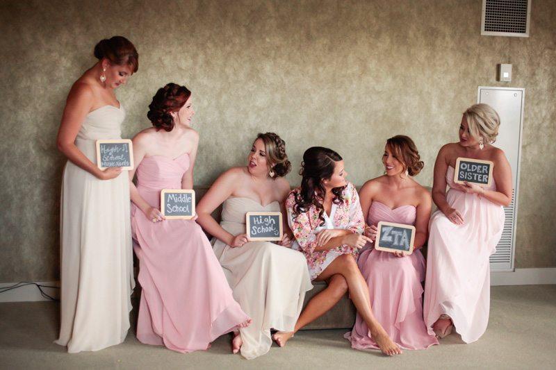 Bridesmaids Holding Chalkboard Descriptions