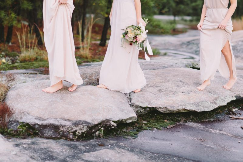 Taupe Dresses Walking Over Rocks_