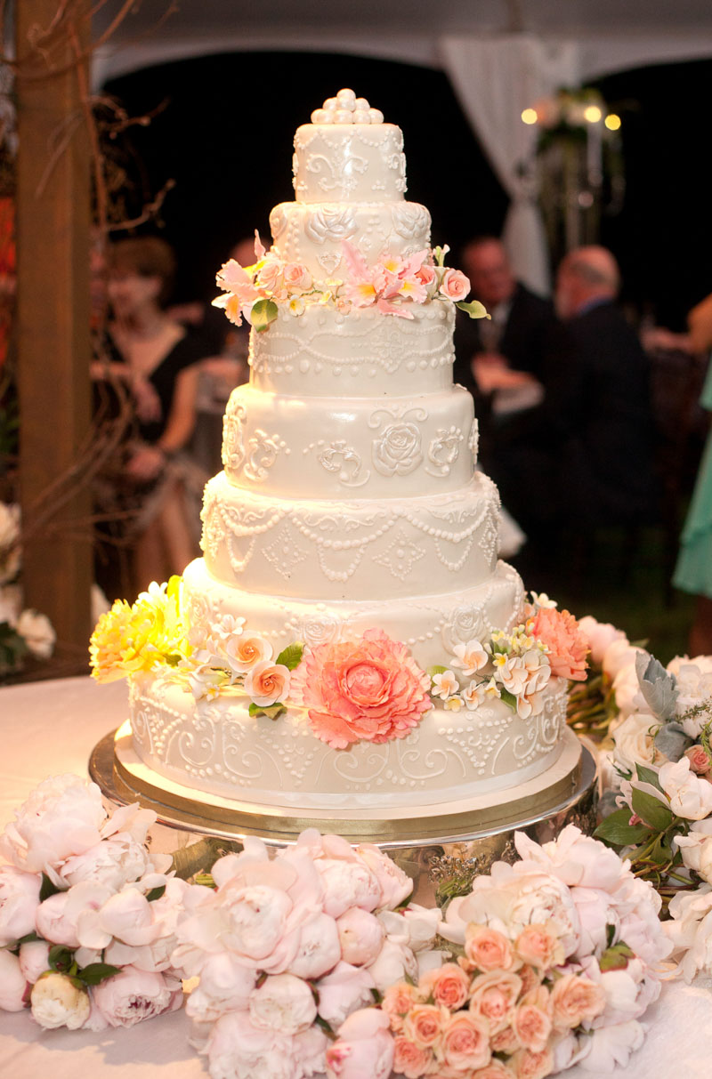 White Cake Surrounded by Flowers