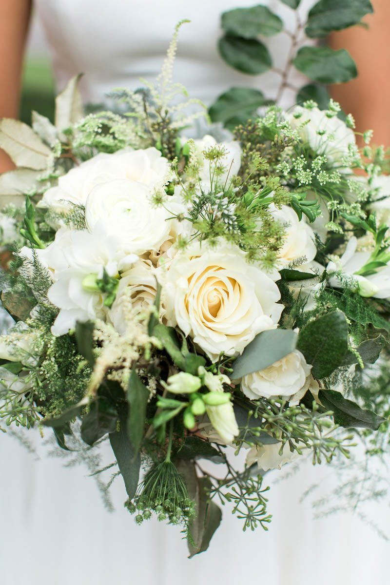bouquet of white roses and greens