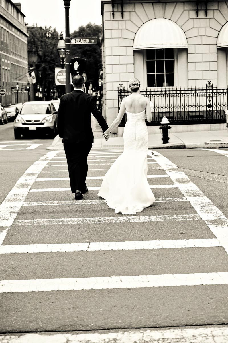 bride and groom walking in the city