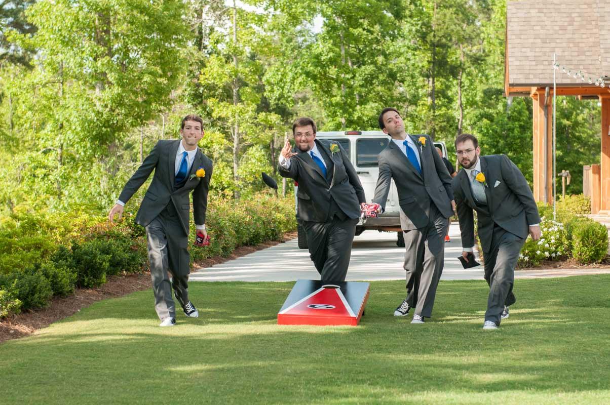 groomsmen playing cornhole