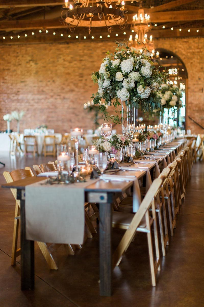 head table at indoor wedding reception with twinkle lights