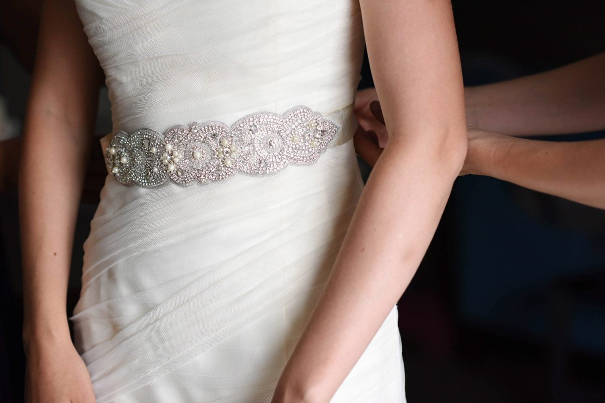 white wedding gown with jewled belt