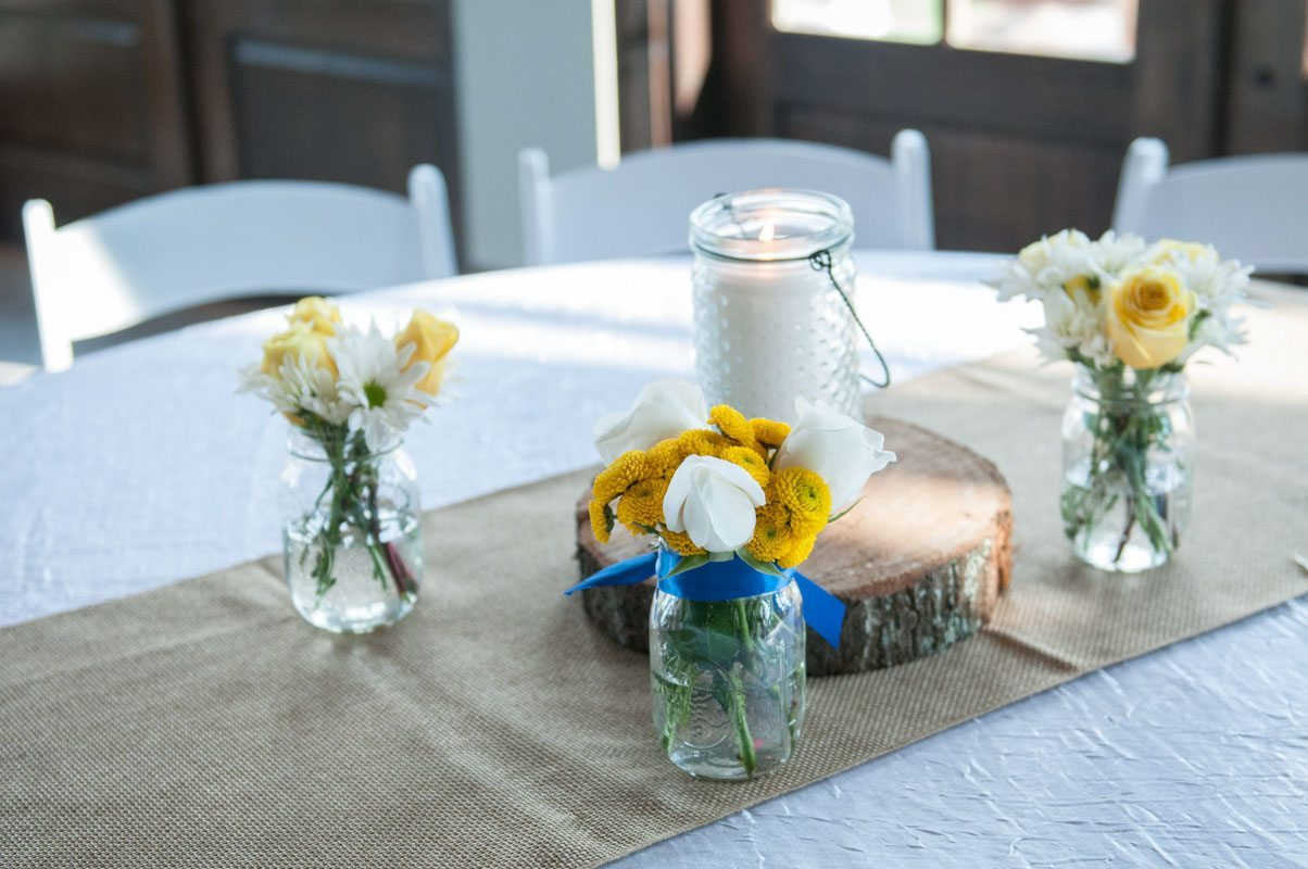 yellow and white floral centerpieces