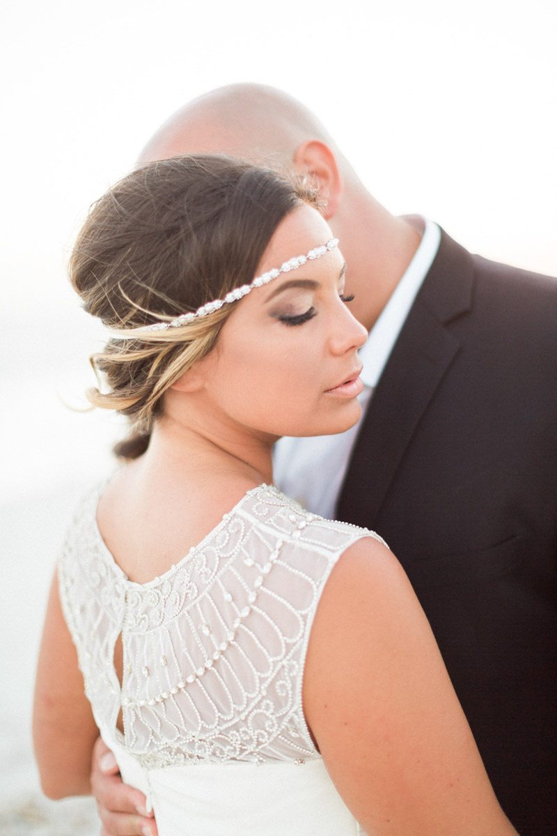 Back of dress makeup and hair details Mirtich_Scordos_Hunter_Ryan_Photo_sanibelislandcasaybelweddingphotographyhunterryanphoto9144
