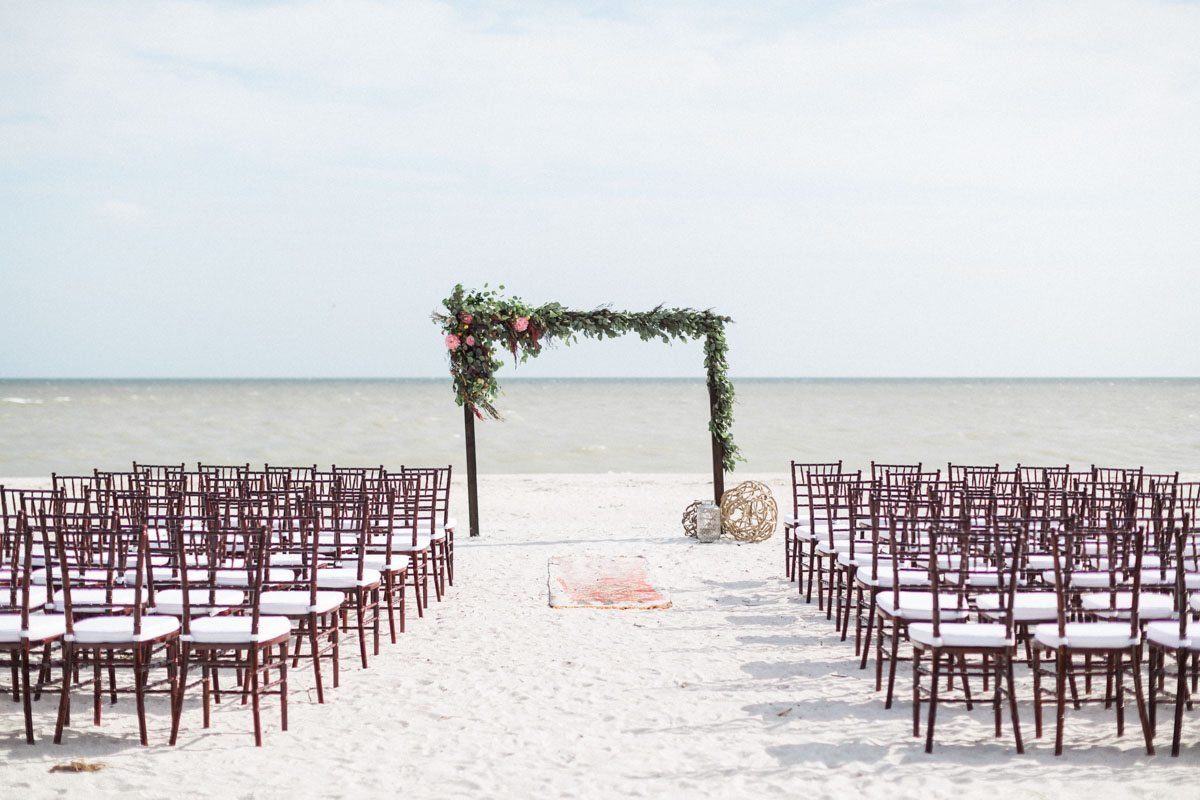 Beach ceremony brown chilvari chair greenery altar decor our-wedding-8191