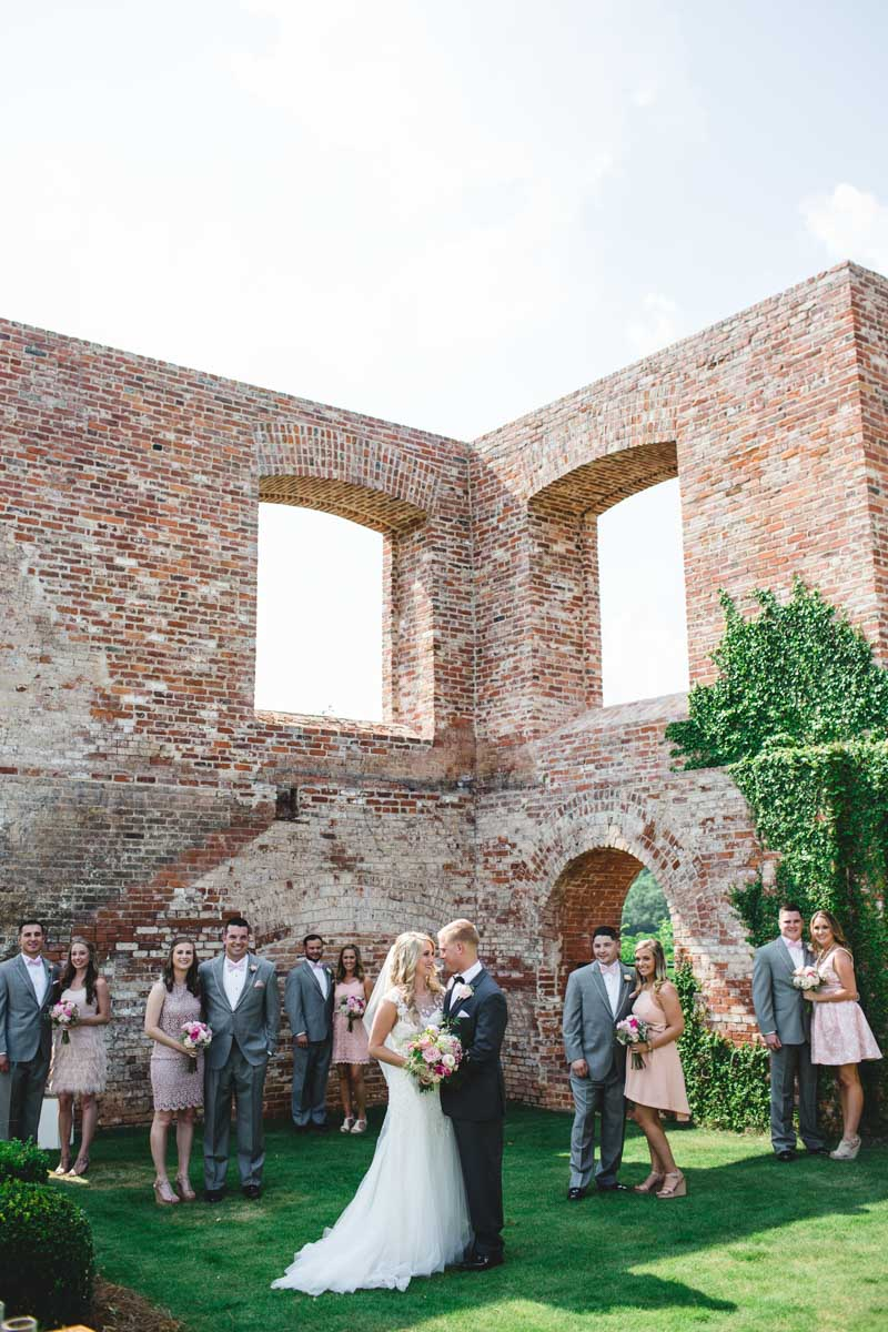 Brick outdoor building bridal party in front in groups of two ErinStephan_172