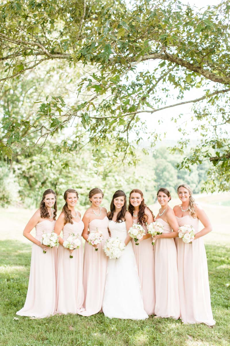 Bride and bridesmaids outside bridal party pose