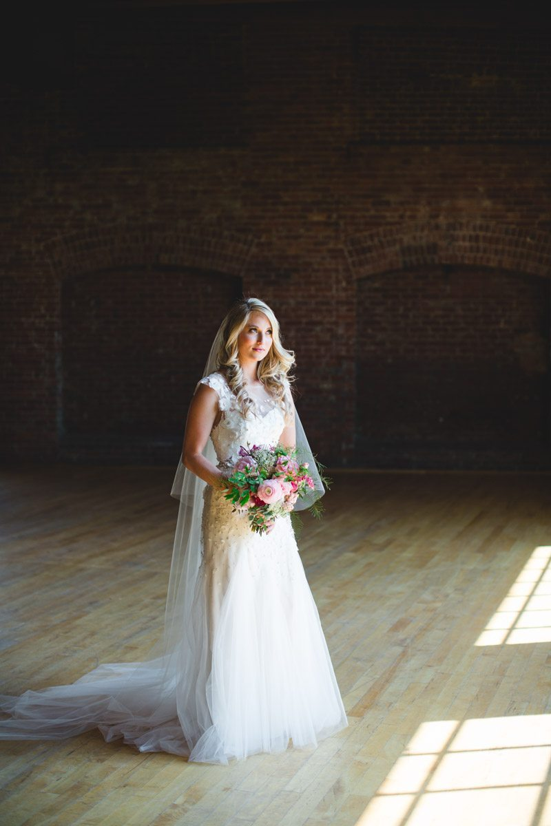 Bride long shot in brick room ErinStephan_133