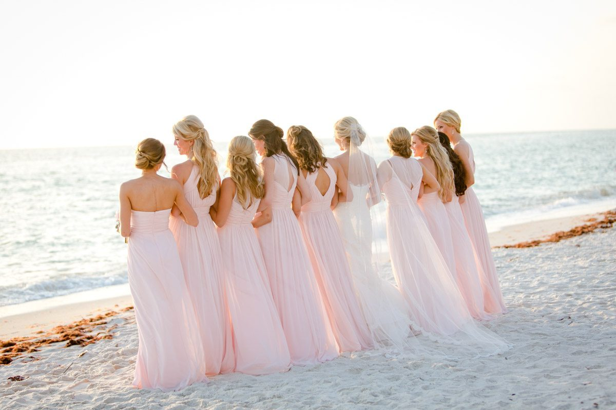 Bridesmaids pale pink floor length gowns facing beach with bride Rakow_Reynolds_Set_Free_Photography_LaPlayaFloridaWeddingSetFreePhotographyFloridaPhotographer1774