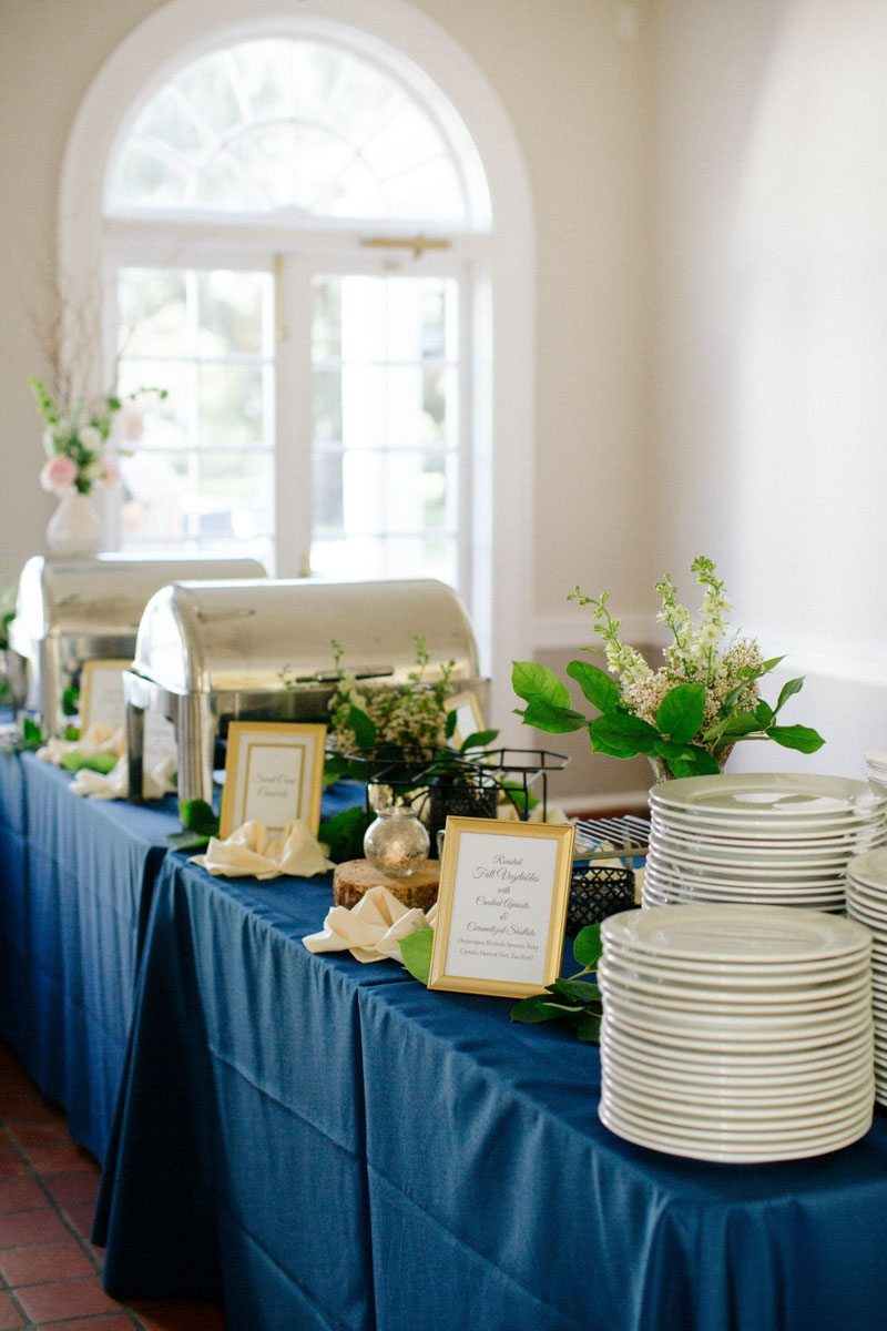Buffett with blue linen and greenery decor Hunter_Gibney_Ais_Portraits_AisPortraitsGibneyRibaultWedding678