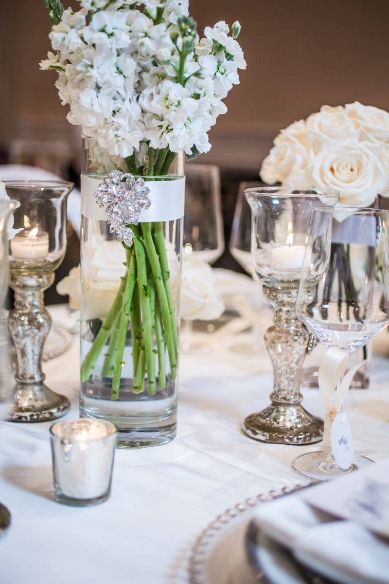 Center Pieces Featuring Tall Flowers, Candle Light and Glass Candle Holders Janet_Howard_Studio_WhiteWedding243
