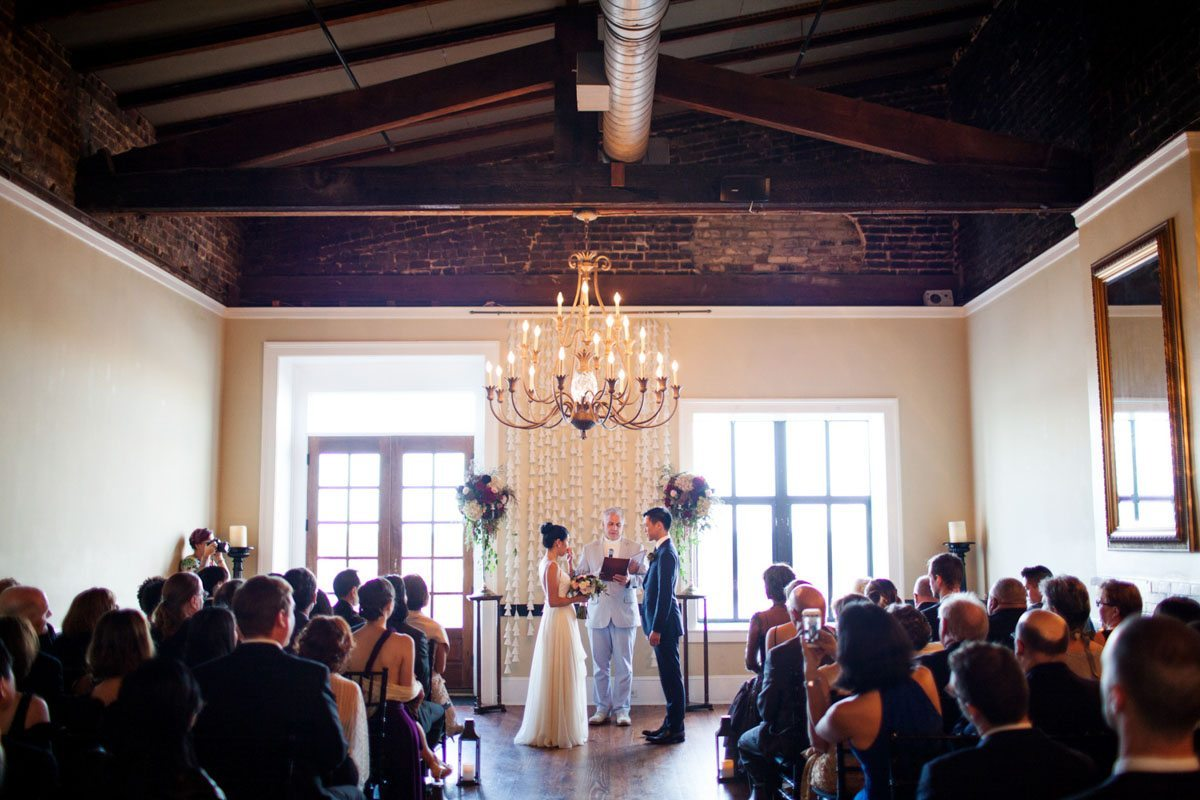 Ceremony indoor space overview with chandelier jadematthew_savannah_vics_40