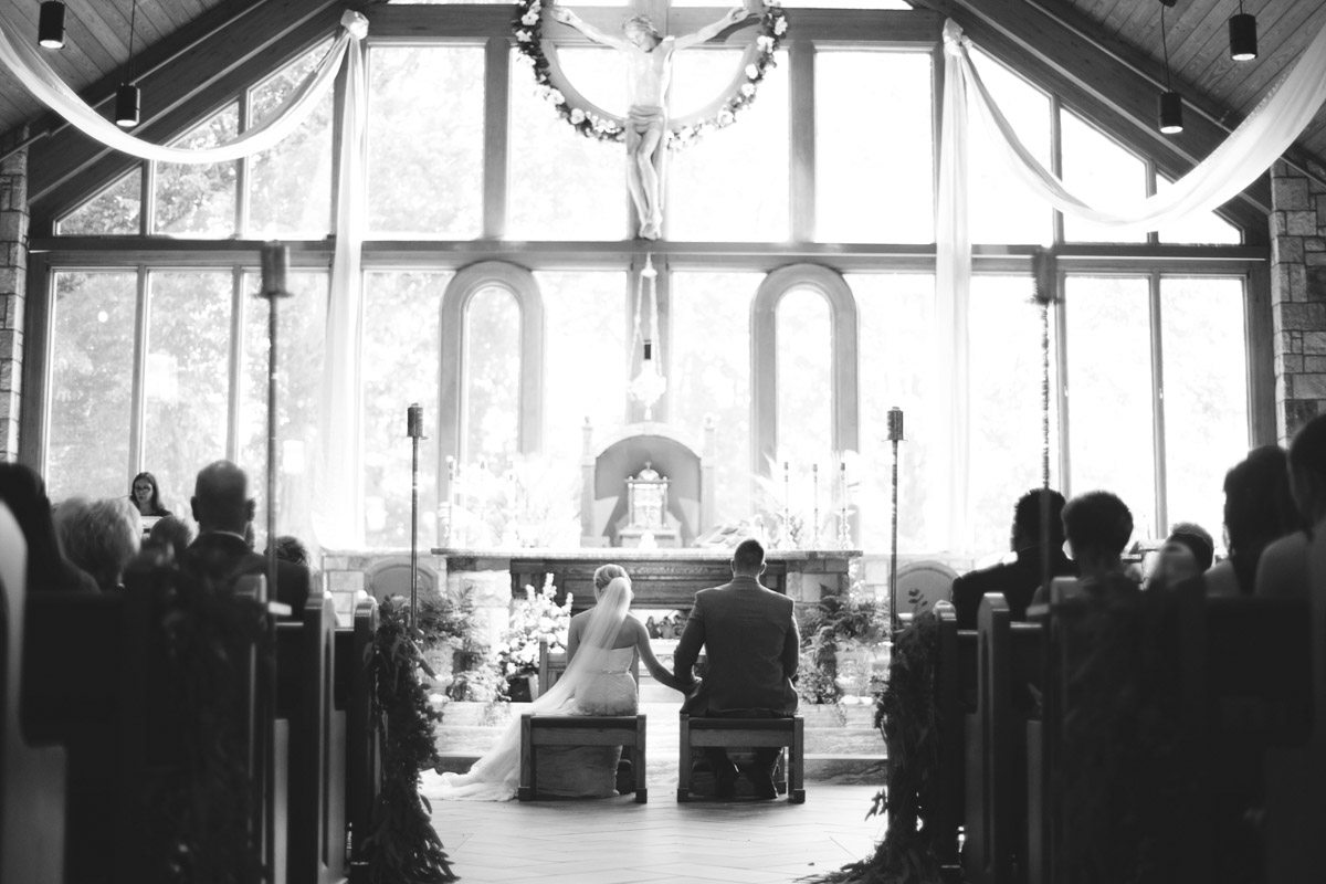 Ceremony overview black and white bride and groom sitting down inside church Ley_Green_Kelly_Anne_Photography_05089146