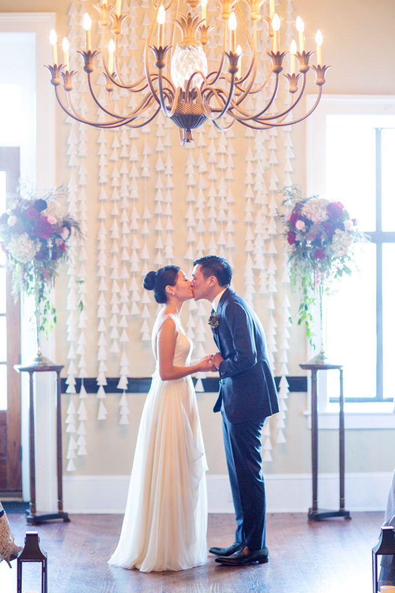 Ceremony space kiss the bride with chandelier and altar flowers jadematthew_savannah_vics_44