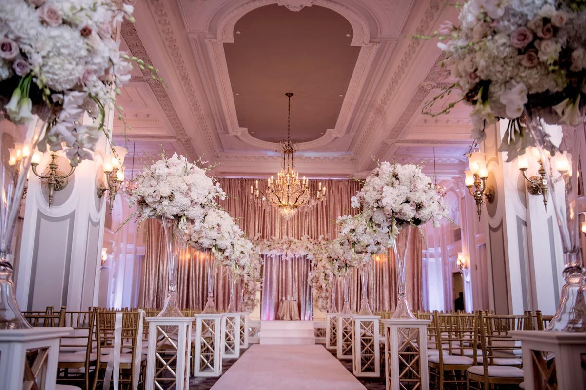 Ceremony space overview blush and pink uplighting chandelier and hydrangia aisle decor Adrienne&Keith_Wedd_0223