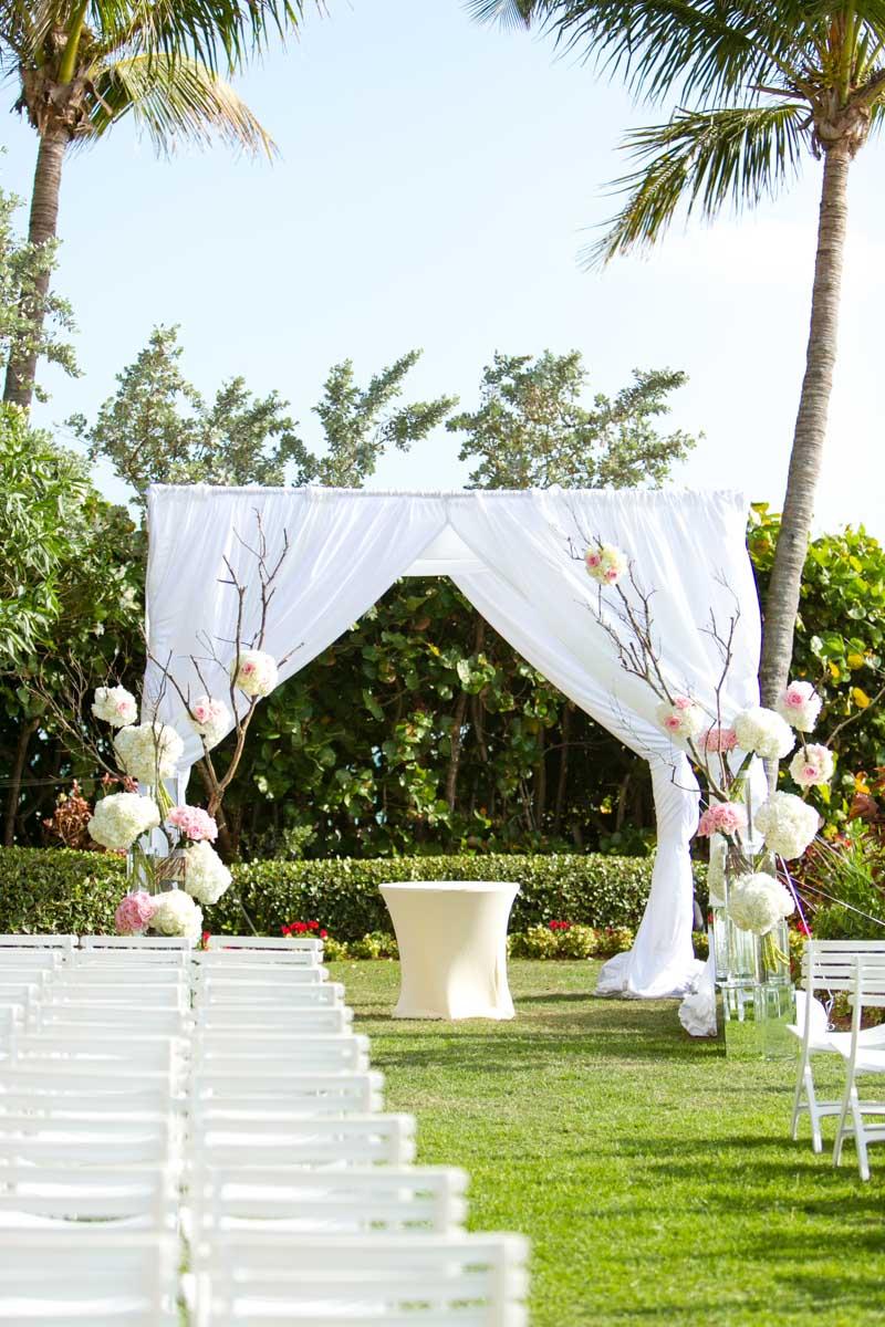 Ceremony space white curtain branch and hydrangea altar decor Rakow_Reynolds_Set_Free_Photography_LaPlayaFloridaWeddingSetFreePhotographyFloridaPhotographer1376