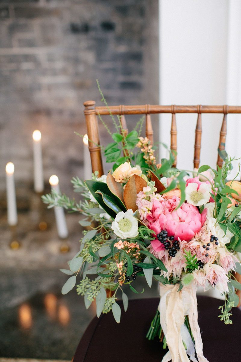 Chair and candle background closeup on bridal bouquet Hunter_Gibney_Ais_Portraits_AisPortraitsGibneyRibaultWedding27