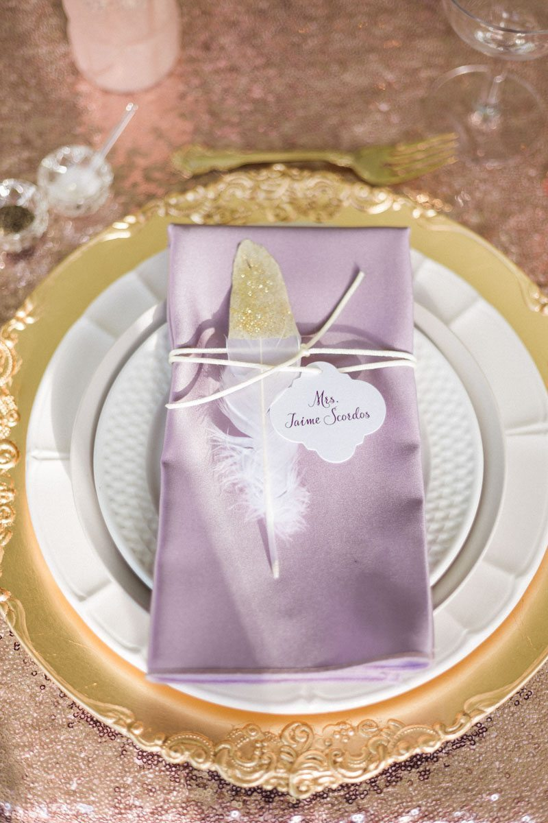 Gold tipped feather gold charger purple napkin table set up Mirtich_Scordos_Hunter_Ryan_Photo_sanibelislandcasaybelweddingphotographyhunterryanphoto5930