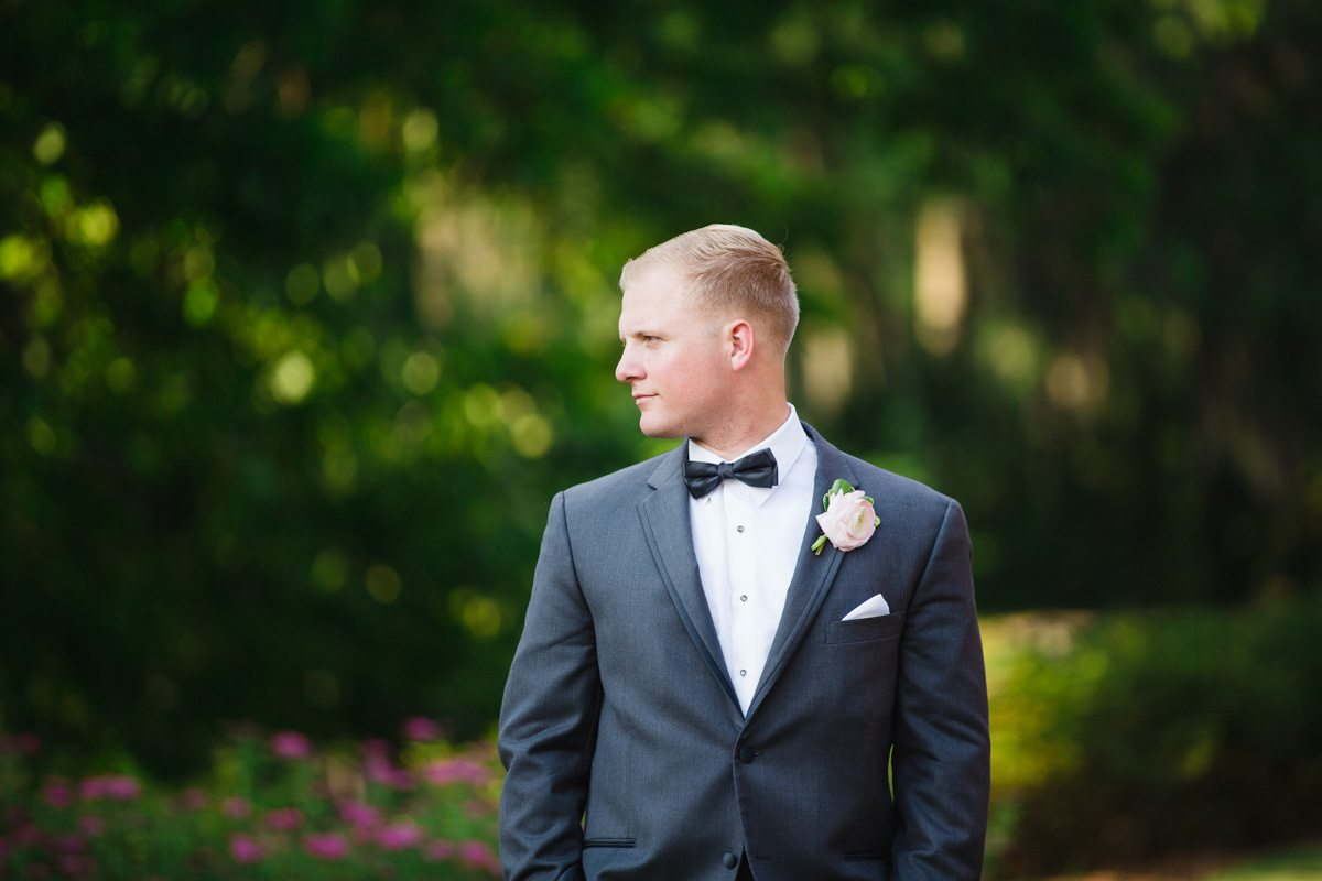 Groom feature in dull black tux and bow tie ErinStephan_335