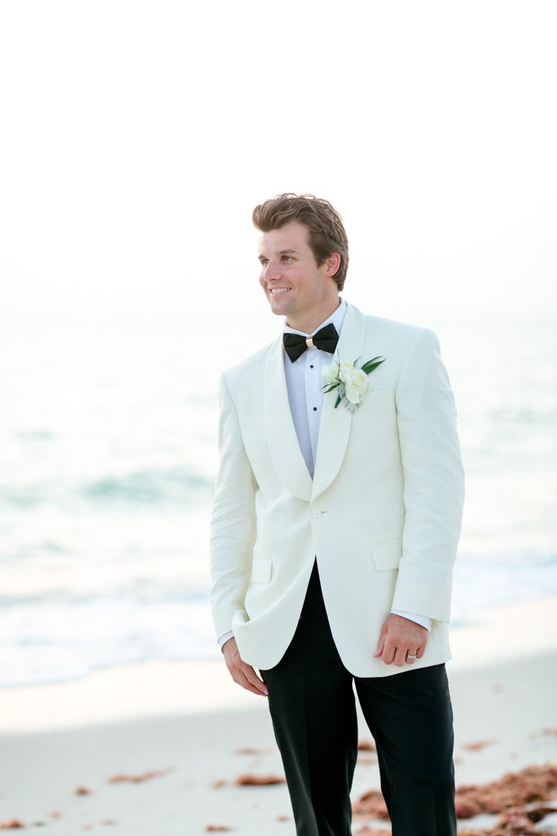 Groom white jacket black trousers and tie Rakow_Reynolds_Set_Free_Photography_LaPlayaFloridaWeddingSetFreePhotographyFloridaPhotographer1900