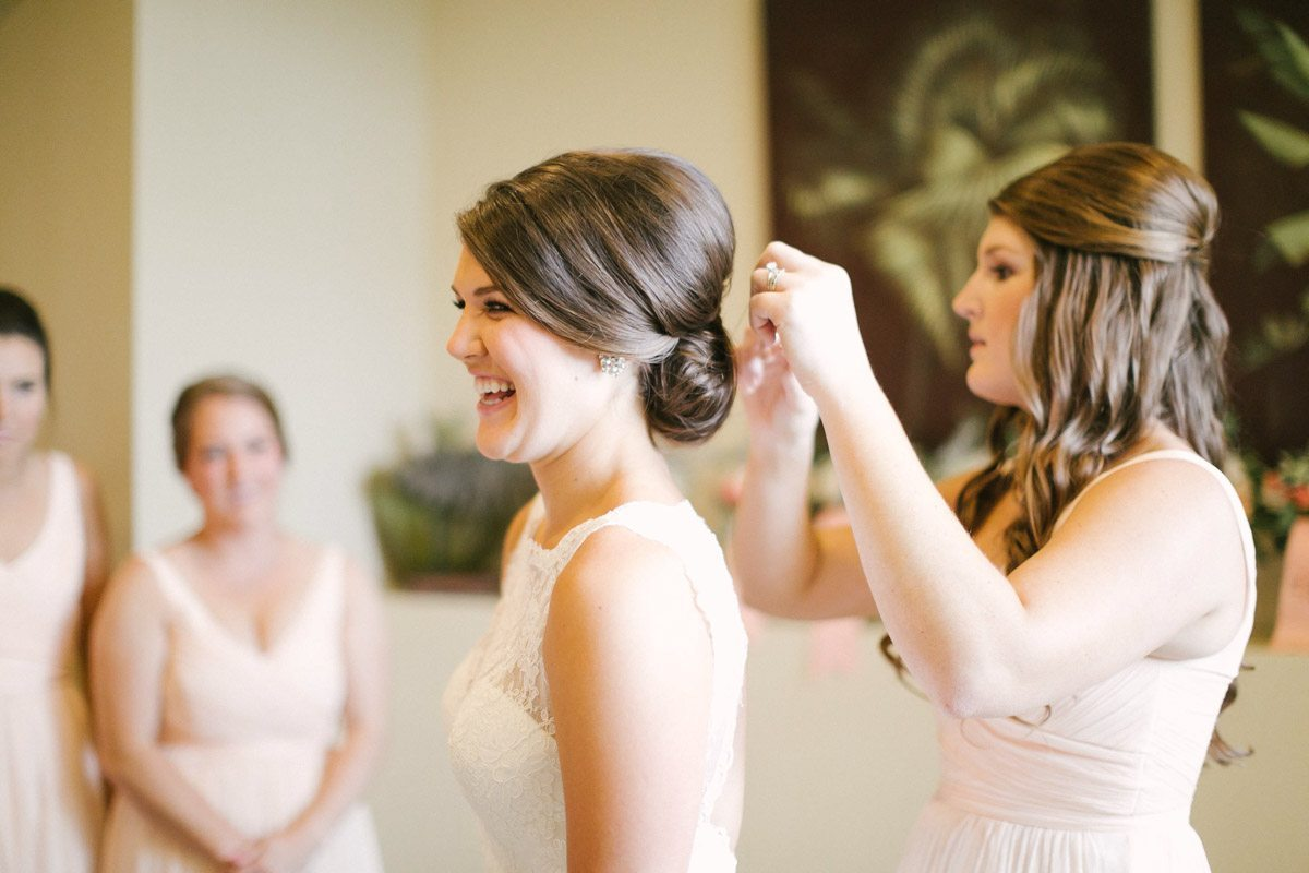 Bridesmaid touching up the bride's up-do Ashley Steeby Photography Destination Weddings www.AshleySteeby.com | Asteeby@gmail.com