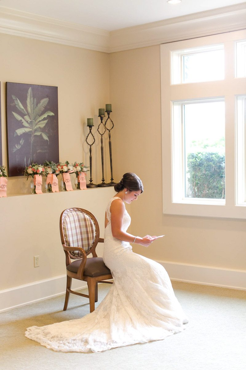 Bride sitting in her dress in front of window with light shining through Ashley Steeby Photography Destination Weddings www.AshleySteeby.com | Asteeby@gmail.com