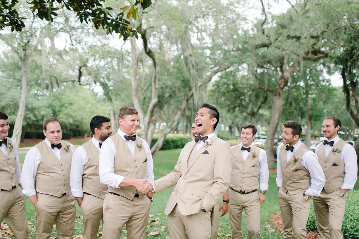 Groom shaking hands with his groomsmen - very excited Ashley Steeby Photography Destination Weddings www.AshleySteeby.com | Asteeby@gmail.com