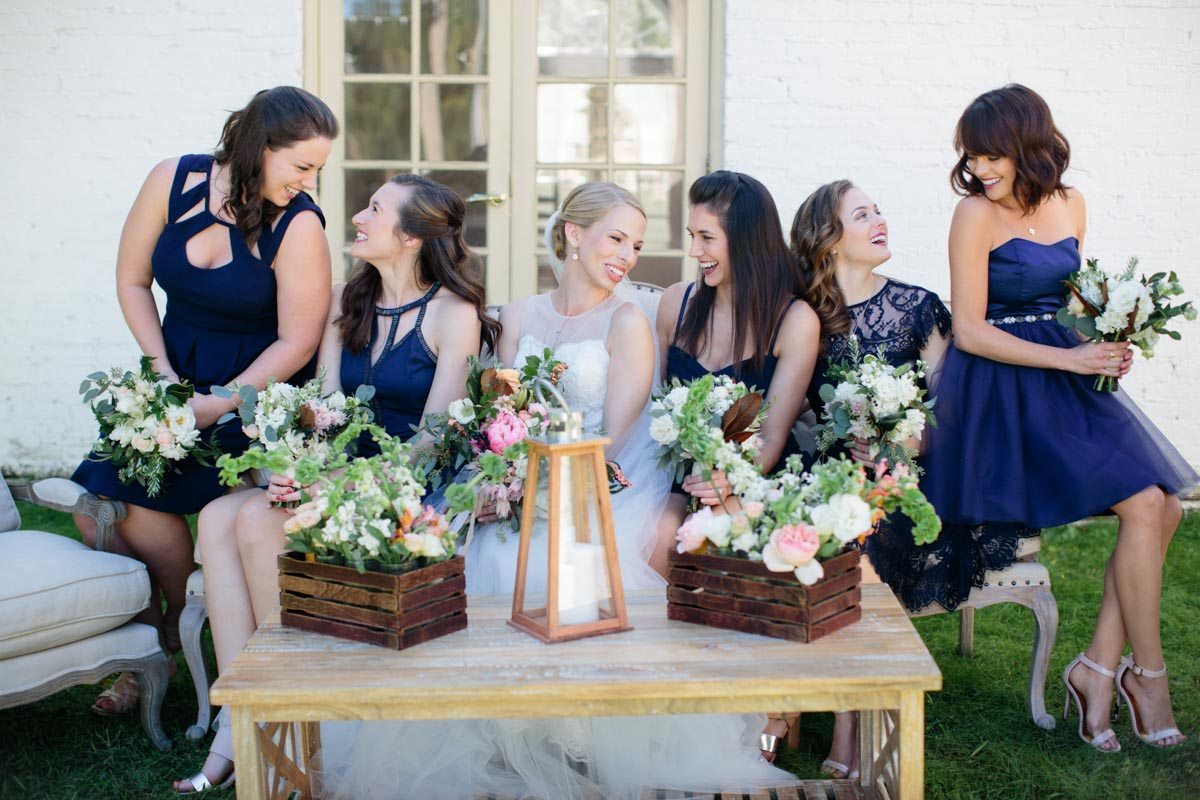 Mismatched navy bridesmaids gowns with peony and greenery bouqets sitting down with bride Hunter_Gibney_Ais_Portraits_AisPortraitsGibneyRibaultWedding96