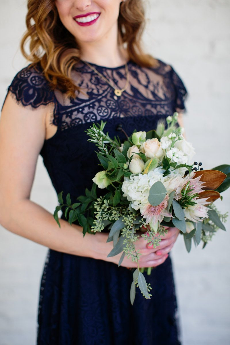 Navy lace bridesmaid dress holding greenery bouquet Hunter_Gibney_Ais_Portraits_AisPortraitsGibneyRibaultWedding84