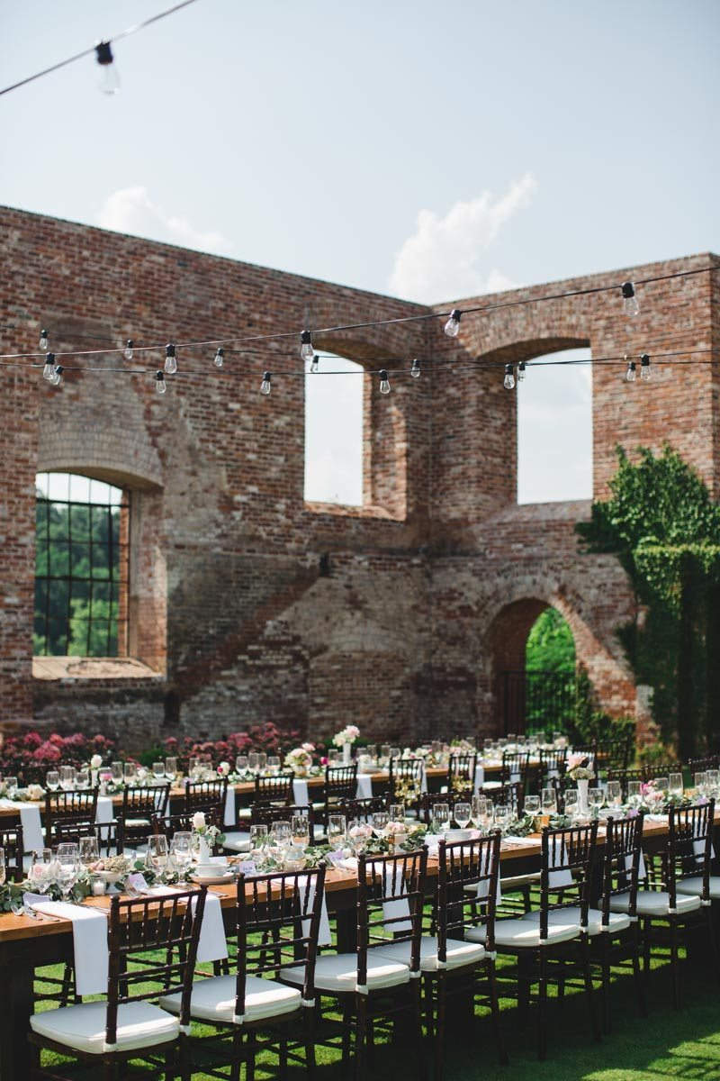 Outdoor brick building farm banquet table string lighting ErinStephan_384