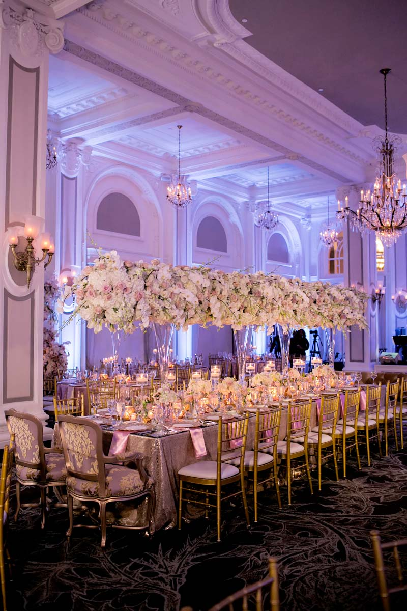 Reception ballroom pink uplighting tall floral center pieces plush head seating gold chilvari chairs Adrienne&Keith_Wedd_0770