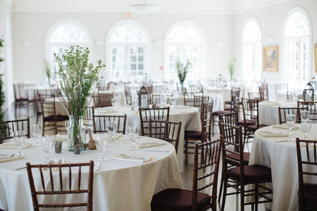 Reception space overview brown chilvari chairs with white linens Hunter_Gibney_Ais_Portraits_AisPortraitsGibneyRibaultWedding658
