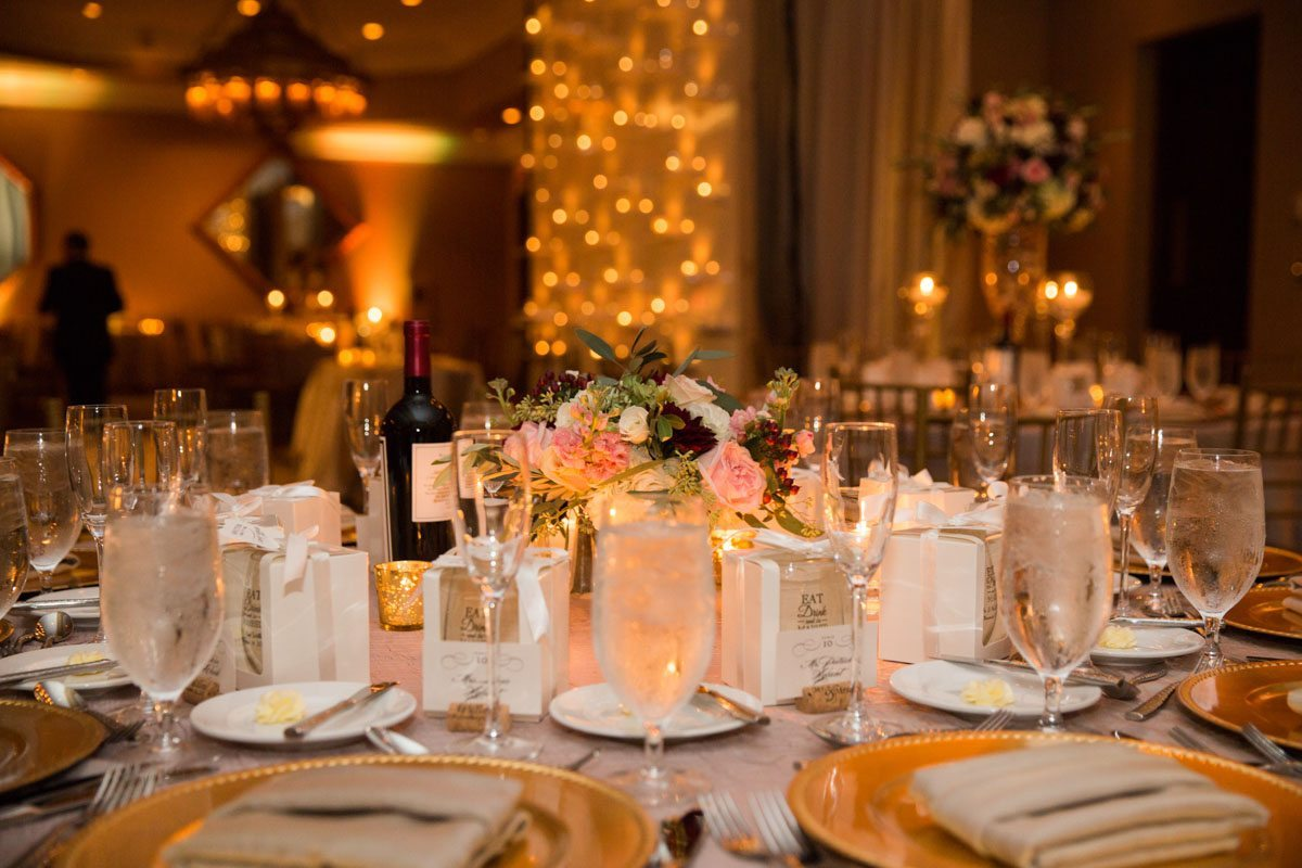 Table details and light background water filled glasses and gold plates with white napkins 11-14-15 Tara and Justin 70