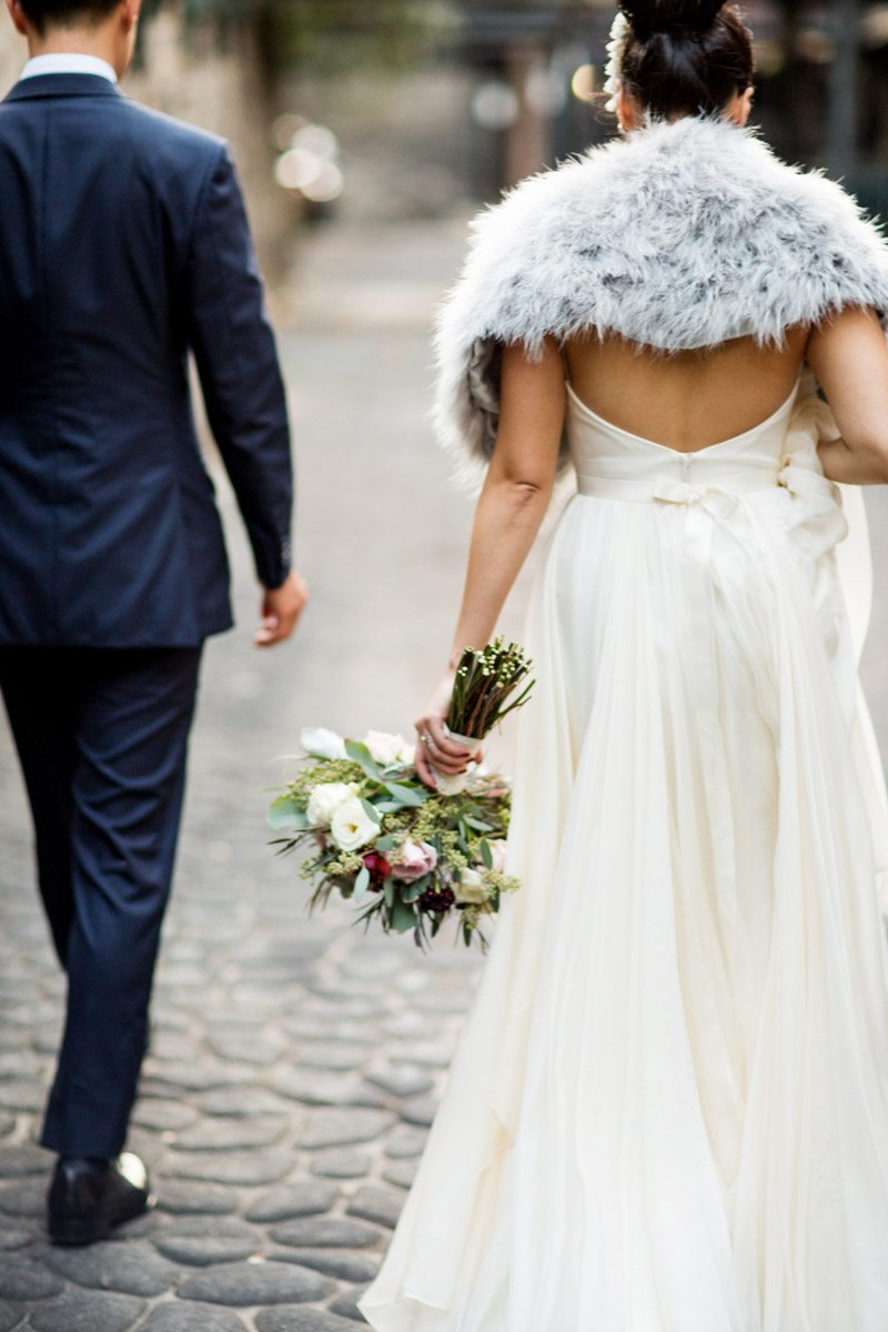 Walking to the reception bride in fur facing away from camera jadematthew_savannah_vics_75