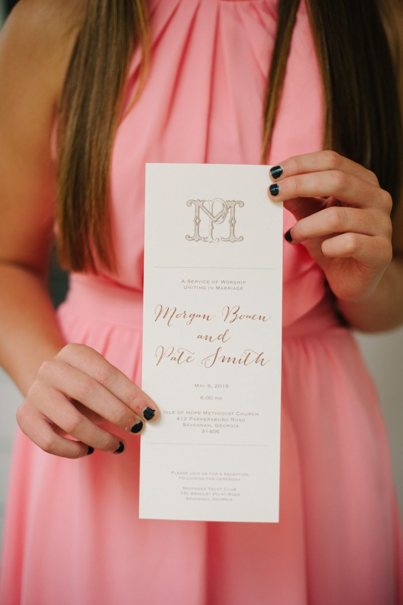 bridesmaid in pink holding invitation Boaen_Smith_Britt_Croft_Photography_smithSUBMIT5