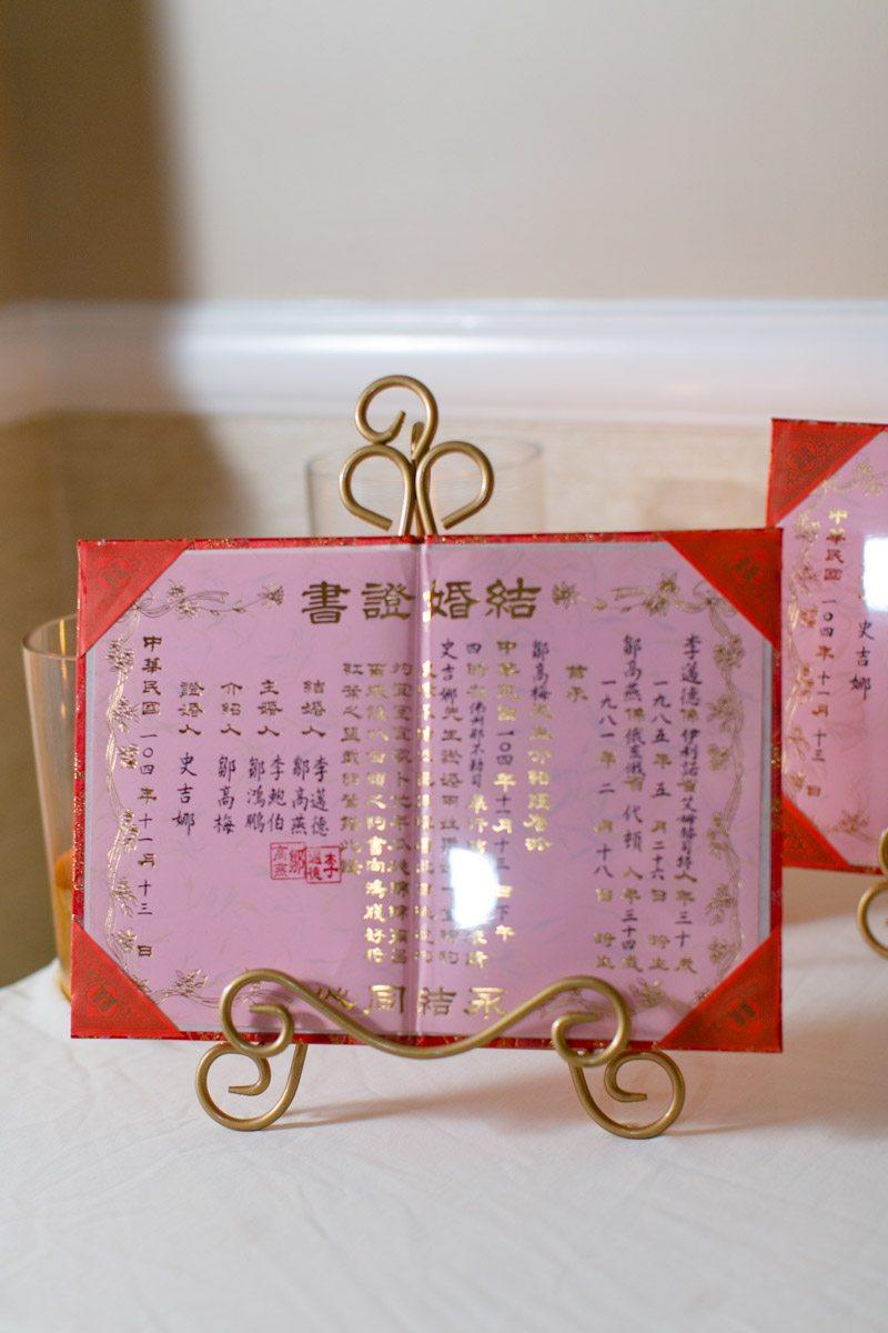Asian red book with writing Tsou_Nealon_Set_Free_Photography_LaPlayaWeddingNaplesPhotographerFloridaSetFreePhotography1930